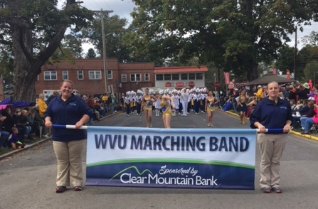 Ashley Rodeheaver and Ashley Nicolas of Clear Mountain Bank's Kingwood branch, proudly led the way for the WVU Marching Band at the Buckwheat Festival parade on Saturday, September 30, 2017.