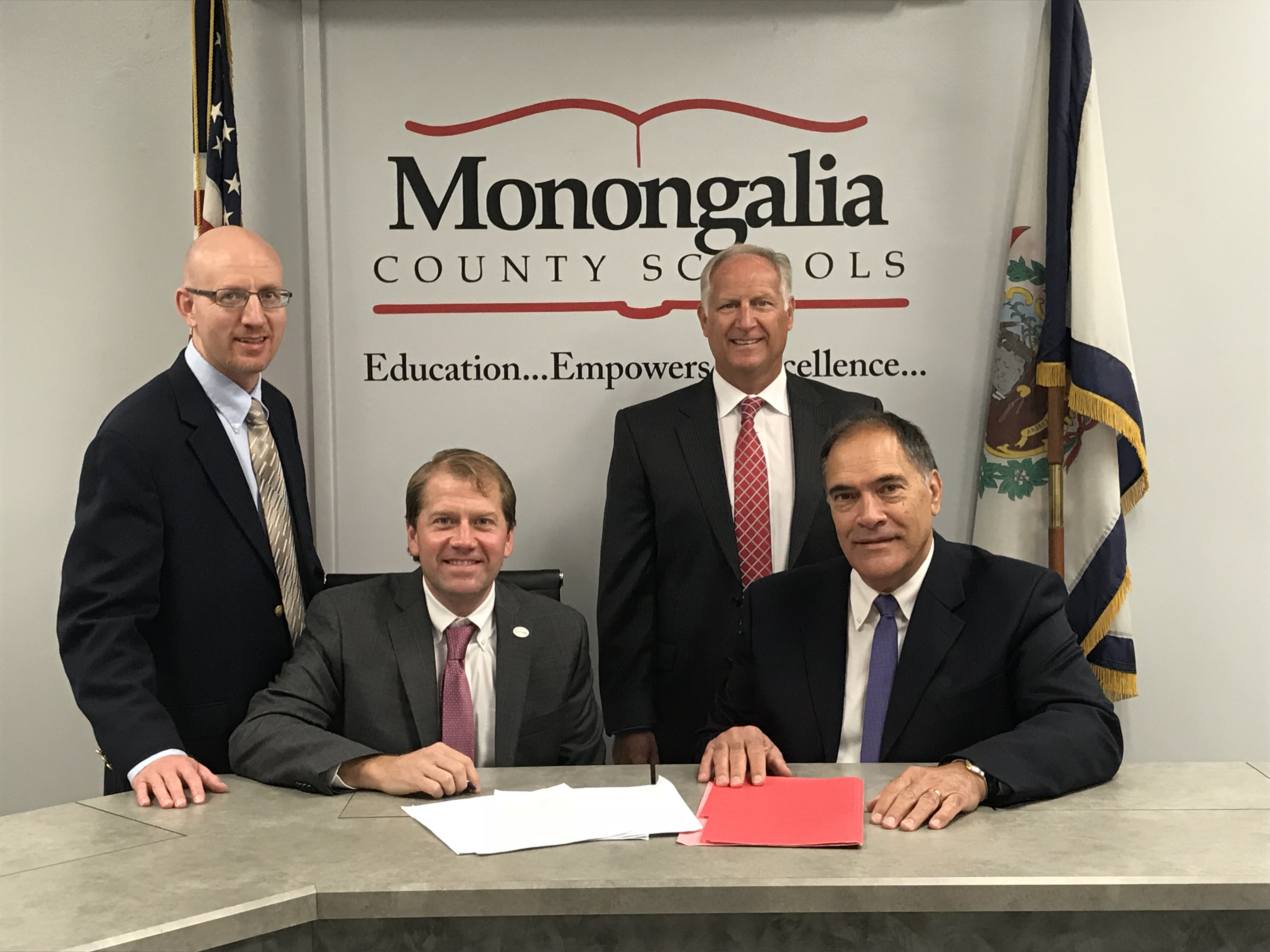 Pictured from left to right are from Clear Mountain Bank: Clint McCabe, COO; David Thomas, President & CEO; Mark Randalls, VP Commercial Lending; and from Monongalia County Schools: Dr. Frank Devono, Superintendent.