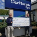 WGW founder Bill Weissgerber, left, accepts a check from David M. Thomas, Clear Mountain Bank president and CEO.