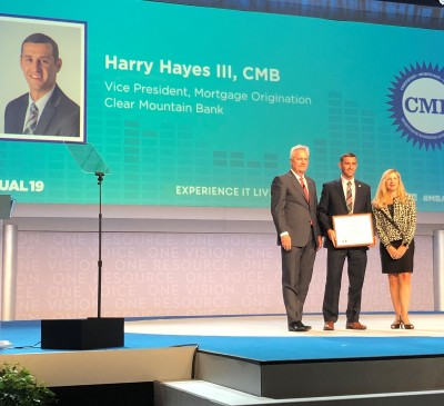 Harry Hayes (center) accepts the CMB designation certificate from Brian Stoffers, CMB and 2020 MBA Chairman (left) and Madeline H. Johnson, CMB - Society Vice-Chair.